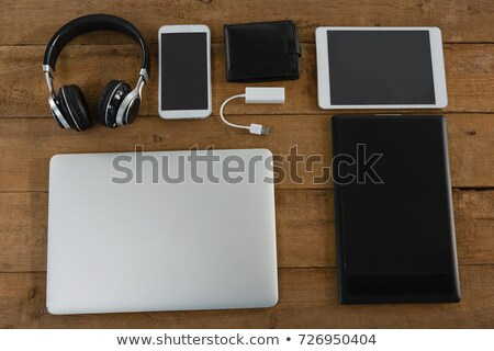 Stock photo: Various electronic gadgets on wooden plank