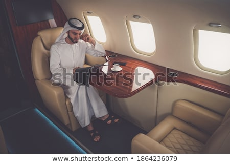 successful muslim businessman reading magazine stock photo © rastudio