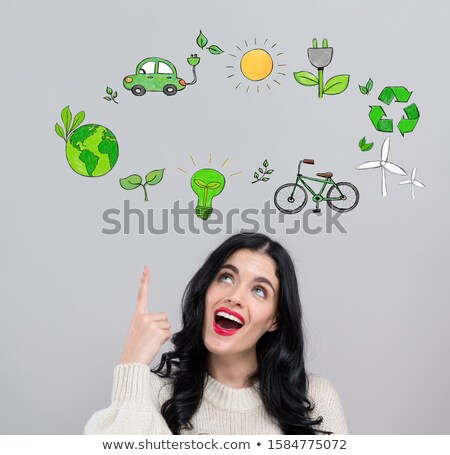 Stock photo: Young woman and windmill by electric car