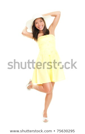 Stock photo: Portrait of an attractive asian woman in dress and hat