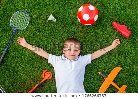 footballers lying around a ball stock photo © is2