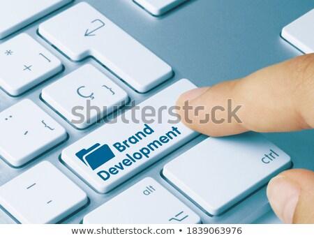 Hand Finger Press Brand Development Key. Stock photo © tashatuvango