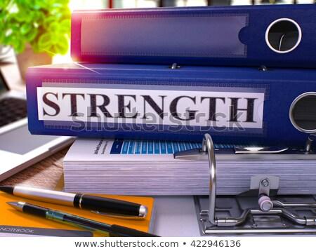 blue ring binder with inscription strength stock photo © tashatuvango