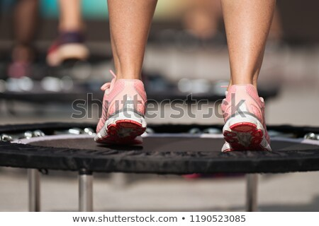 Woman jumping on exercise trampoline Stock photo © IS2