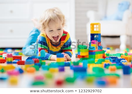 Boy playing with building blocks Stock photo © IS2