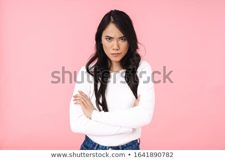 Photo of resented woman in casual clothes standing with arms fol Stock photo © deandrobot