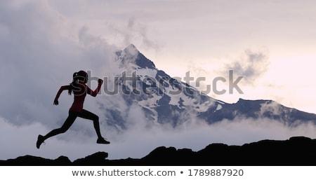 trail running woman in winter mountains stock photo © blasbike