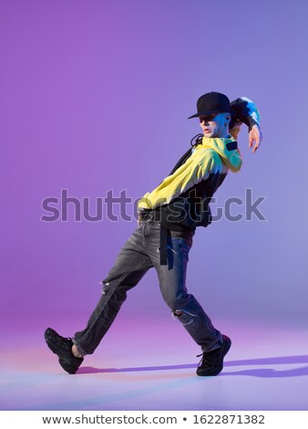 modern young man dancing baseball cap Stock photo © studiostoks