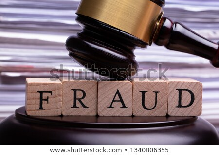 Wooden Gavel Striking On Wooden Block With Fraud Word Stock photo © AndreyPopov