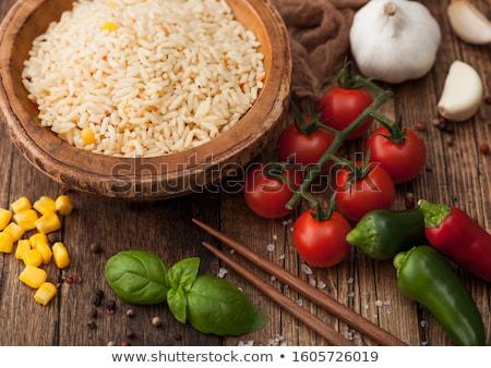 Bois plaque bol riz tomate basilic Photo stock © DenisMArt