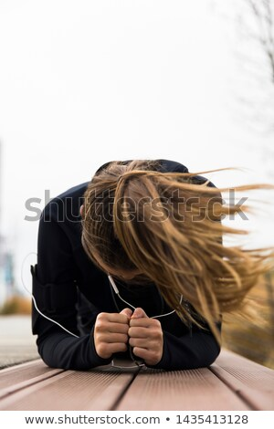若い女性 訓練 風の強い 日 屋外 スポーツ ストックフォト © boggy