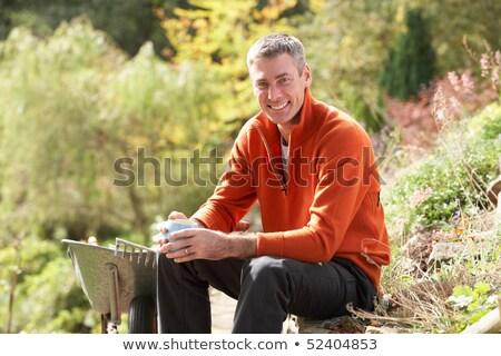 man having coffee break whilst working outdoors in garden stock photo © monkey_business