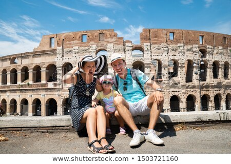 Young Mother And Daughter Sitting In Front Of Colosseum Stock photo © AndreyPopov