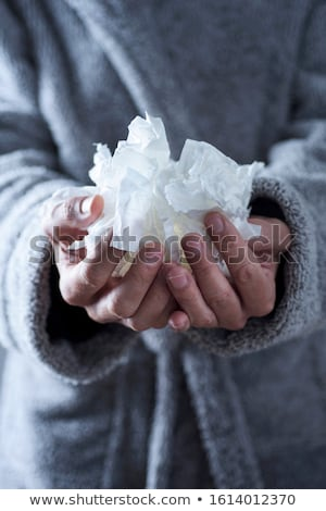 ill man with used tissues in his hands Stock photo © nito