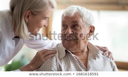 Aandachtig vrouwelijke arts diagnose patiënt professionele Stockfoto © vkstudio