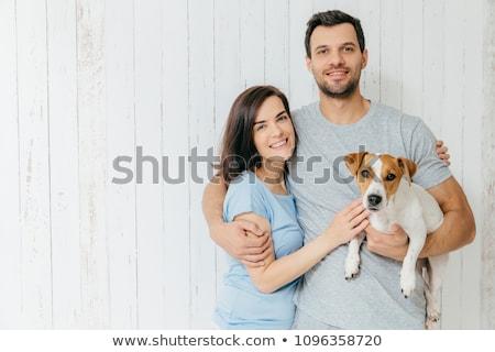 Tiro atraente mulher jovem favorito cão nariz Foto stock © vkstudio