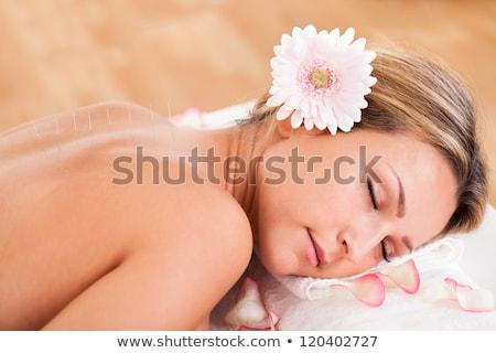 Acupunctuur huidbehandeling vrouwen gezicht masker hand Stockfoto © AndreyPopov
