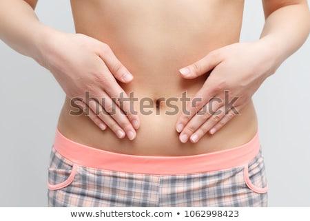 Donna stomaco abbassare Foto d'archivio © Forgiss