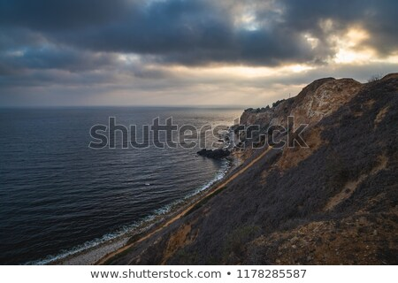 Sunset over Pacific Ocean and steep cliffs in California Stock photo © mtilghma