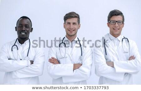 Três profissionais mulheres reunião equipe retrato Foto stock © photography33