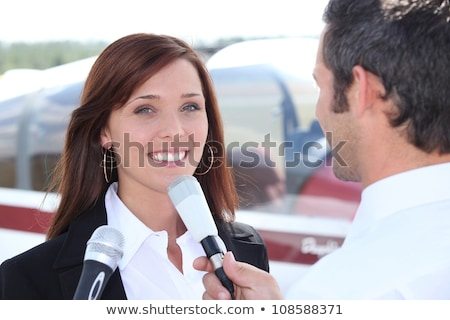 Reporter interviewing woman in airport Stock photo © photography33