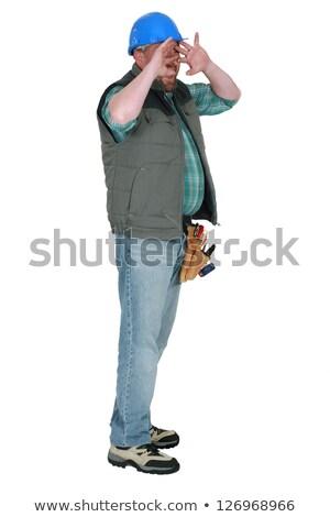 Tradesman shielding his face Stock photo © photography33