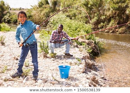 peu · garçon · canne · à · pêche · tige · séance · lac - photo stock © photography33