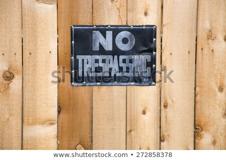 No trespassing on a wood wall Stock photo © jeremywhat