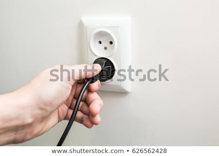 Man putting finger in electrical socket Stock photo © photography33