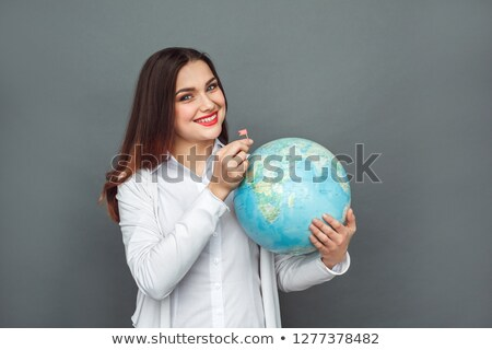 woman looking at globe stock photo © photography33