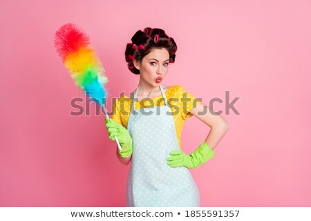 Housewife blowing on her duster Stock photo © photography33