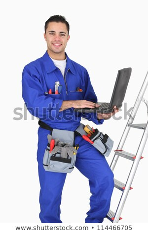 tradesman posing with his tools and laptop stock photo © photography33