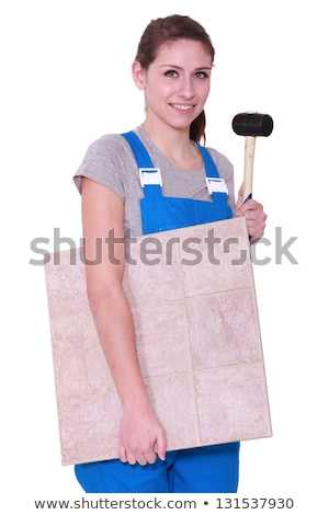 young woman holding tiles an a hammer Stock photo © photography33