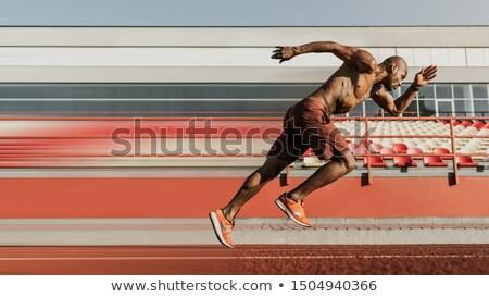 Sporty male sprinter training in a stadium Stock photo © wavebreak_media