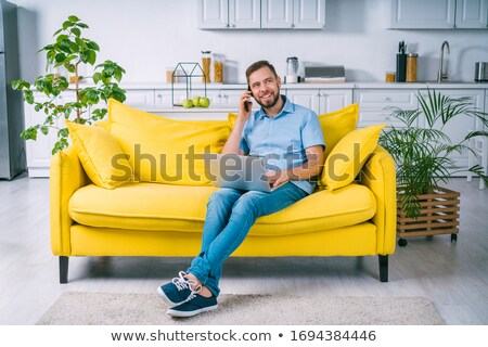 Boy dressed in a businessman using a laptop computer making a 'telephone' sign with his hand Stock photo © photography33