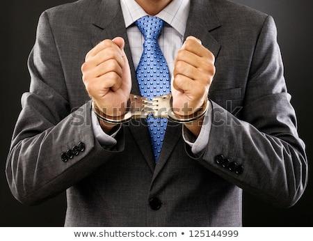 Hombre metal esposas gris signo clave Foto stock © michaklootwijk