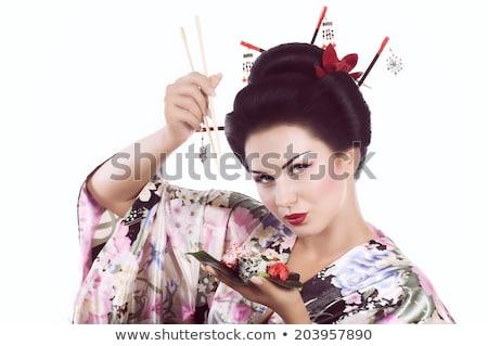 Nő kimonó tart evőpálcikák fehér divat Stock fotó © wavebreak_media