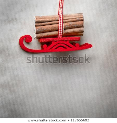 Santa's fairy Christmas decorative sleigh hanging on a ribbon. O Stock photo © HASLOO
