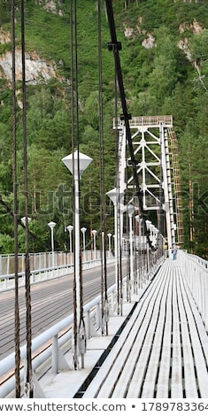 Stock photo: old suspension bridge above Katun