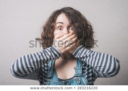 Young woman with hand over her mouth and shock Stock photo © bmonteny