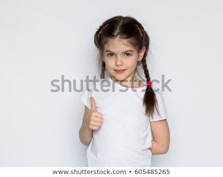 Petite fille blanche tshirt geste Photo stock © dolgachov