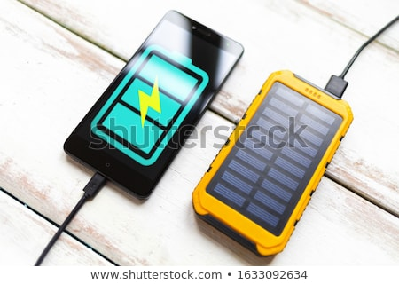 Charging cell phone with solar charger Stock photo © adamr