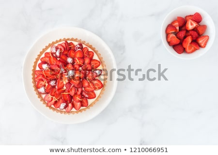 a lemon cake on white plate with strawberries close up stock photo © julietphotography