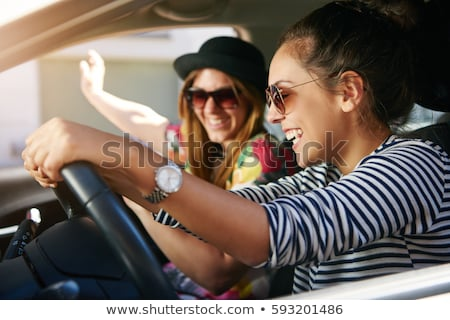 Vivacious young woman listening to music Stock photo © dash