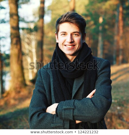 Moço sorridente inverno roupa branco Foto stock © alexandrenunes