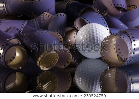 Close-up of a roll 35 mm photographic films and golf ball Stock photo © CaptureLight