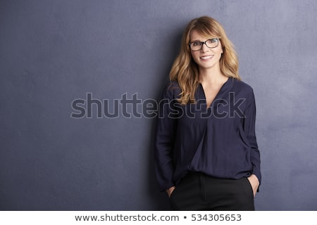 Beautiful woman standing on gray background Stock photo © deandrobot