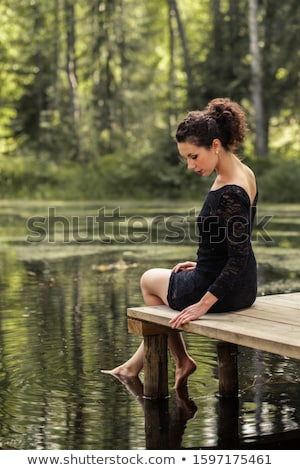 young lady dipping her feets Stock photo © Klinker
