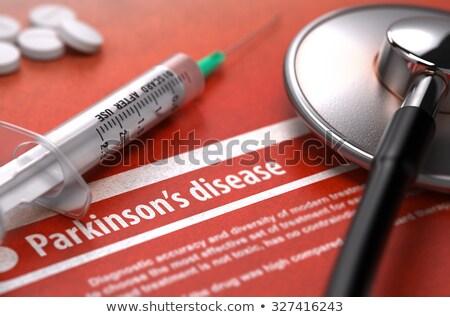 Parkinson's disease - Printed Diagnosis on Orange Background. Stock photo © tashatuvango