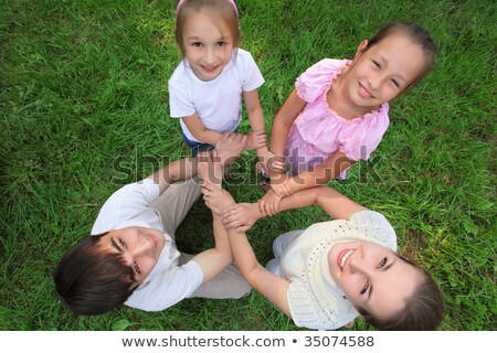 Parents with children stand having joined hands   crosswise,  to Stock photo © Paha_L